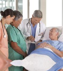 medical staff assisting senior man