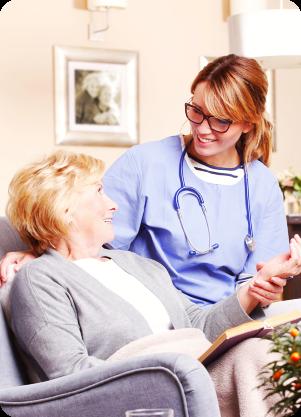 caregiver comforting senior woman